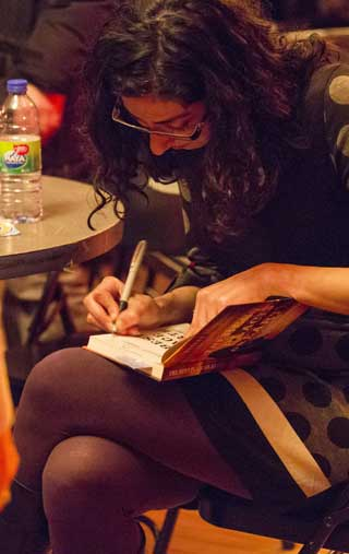 Ayelet signing books at an event